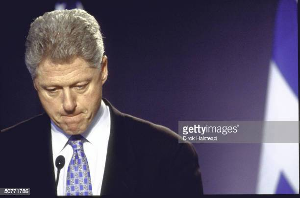 Crestfallen US Pres Bill Clinton in somber portrait when asked about his possible resignation re Lewinsky scandal during joint news conference w...