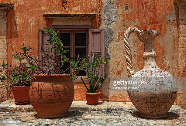 Crete peninsula Akrotiri Moni Agada Triada cloister of the holy Trinity in the inner courtyard of the cloister arrangement windows flowerpots and old...
