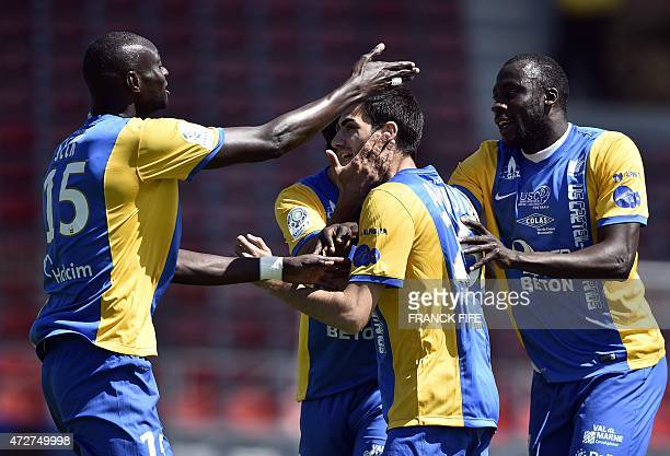 Creteil's defender Augusto Pereira Loureiro is congratuled by teammates after scoring a goal during the French L2 football match between Creteil...
