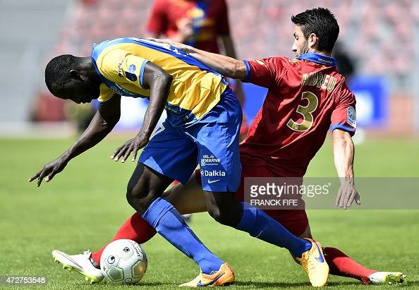 creteil 39 s midfielder cheikh ndoye l vies with gazelec ajaccio 39 s defender yohann andreu during. Black Bedroom Furniture Sets. Home Design Ideas
