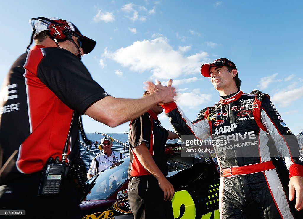 Crew chief Alan Gustafson congratulates Jeff Gordon driver of the Drive to End Hunger Chevrolet during qualifying for the NASCAR Sprint Cup Series...