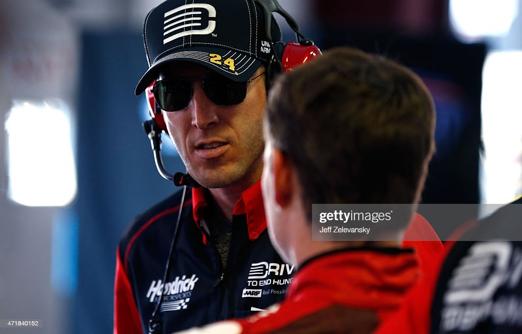 Crew chief Alan Gustafson talks to Jeff Gordon driver of the Drive To End Hunger Chevrolet in the garage area during practice for the NASCAR Sprint...