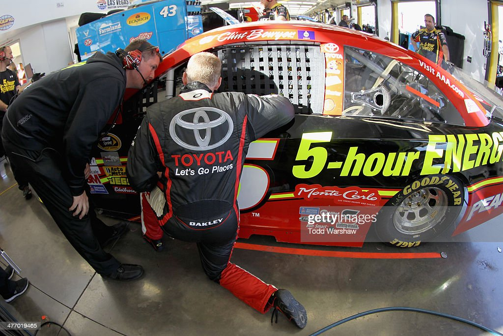 Crew chief Brian Pattie, and <a gi-track='captionPersonalityLinkClicked' href=/galleries/search?phrase=Jeff+Burton&family=editorial&specificpeople=216559 ng-click='$event.stopPropagation()'>Jeff Burton</a>, driver of the #66 Let's Go Places Toyota, talk with <a gi-track='captionPersonalityLinkClicked' href=/galleries/search?phrase=Clint+Bowyer&family=editorial&specificpeople=537951 ng-click='$event.stopPropagation()'>Clint Bowyer</a> (in car), driver of the #15 5-Hour Energy Toyota, during a testing session at Las Vegas Motor Speedway on March 6, 2014 in Las Vegas, Nevada.