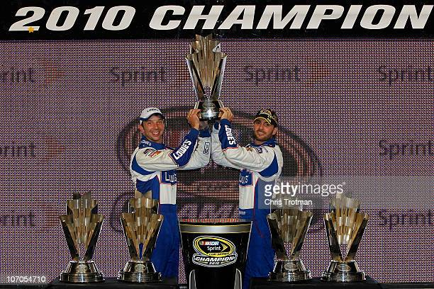 Crew chief Chad Knaus and Jimmie Johnson driver of the Lowe's Chevrolet celebrate their fifth consecutive NASCAR Sprint Cup championship at...