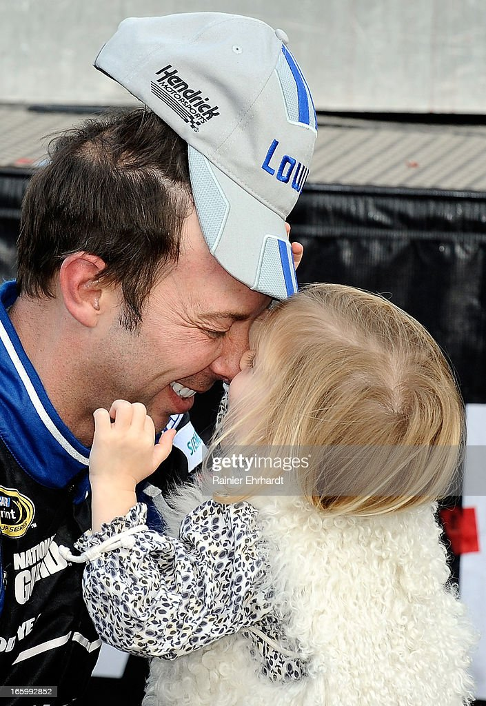 Crew chief Chad Knaus (L), celebrates in Victory Lane with driver Jimmie Johnson's daughter Genevieve Johnson after the NASCAR Sprint Cup Series STP Gas Booster 500 on April 7, 2013 at Martinsville Speedway in Ridgeway, Virginia.