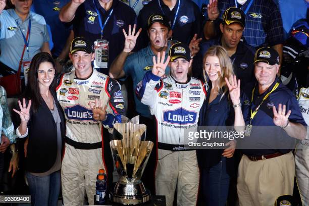Crew chief Chad Knaus girlfriend Lisa Rockelmann Jimmie Johnson driver of the Lowe's Chevrolet poses with his wife Chandra after winning the NASCAR...
