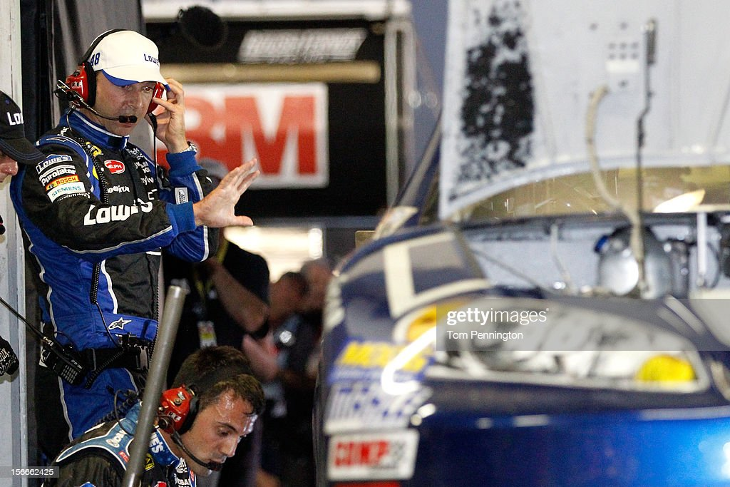 Crew chief <a gi-track='captionPersonalityLinkClicked' href=/galleries/search?phrase=Chad+Knaus&family=editorial&specificpeople=564401 ng-click='$event.stopPropagation()'>Chad Knaus</a> looks over the #48 Lowe's Chevrolet as crew members work on it in the garage after an incident in the NASCAR Sprint Cup Series Ford EcoBoost 400 at Homestead-Miami Speedway on November 18, 2012 in Homestead, Florida.