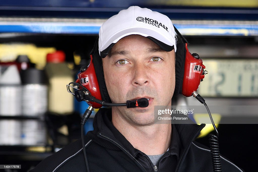 Crew chief <a gi-track='captionPersonalityLinkClicked' href=/galleries/search?phrase=Chad+Knaus&family=editorial&specificpeople=564401 ng-click='$event.stopPropagation()'>Chad Knaus</a> of the #48 Lowe's/ Kobalt Tools Chevrolet driven by Jimmie Johnson, looks on from the garage area prior to practice for the NASCAR Sprint Cup Series Subway Fresh Fit 500 at Phoenix International Raceway on March 2, 2012 in Avondale, Arizona. NASCAR suspended Knaus for six races and fined him $100,000 for failing an inspection last week in Daytona. Knaus will continue his crew chief duties while Hendrick Motorsports appeals NASCAR's decision. An appeal date hasn't been announced.