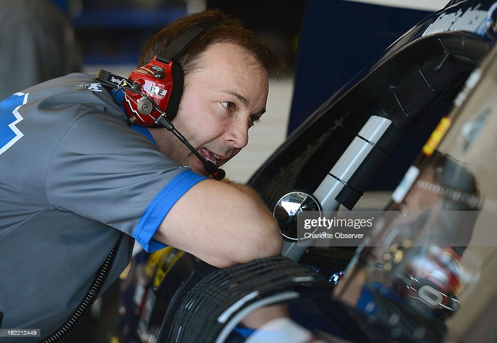 NASCAR crew chief Chad Knaus talks with driver Jimmie Johnson following practice laps on Wednesday, Febraury 20, 2013, at Daytona International Speedway in Daytona Beach, Florida.