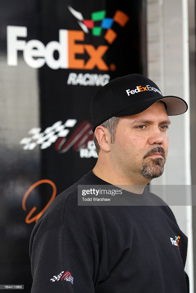 Crew chief Darian Grubb of the #11 FedEx Express Toyota, stands in the garage area during practice for the NASCAR Sprint Cup Series Auto Club 400 at Auto Club Speedway on March 23, 2013 in Fontana, California.