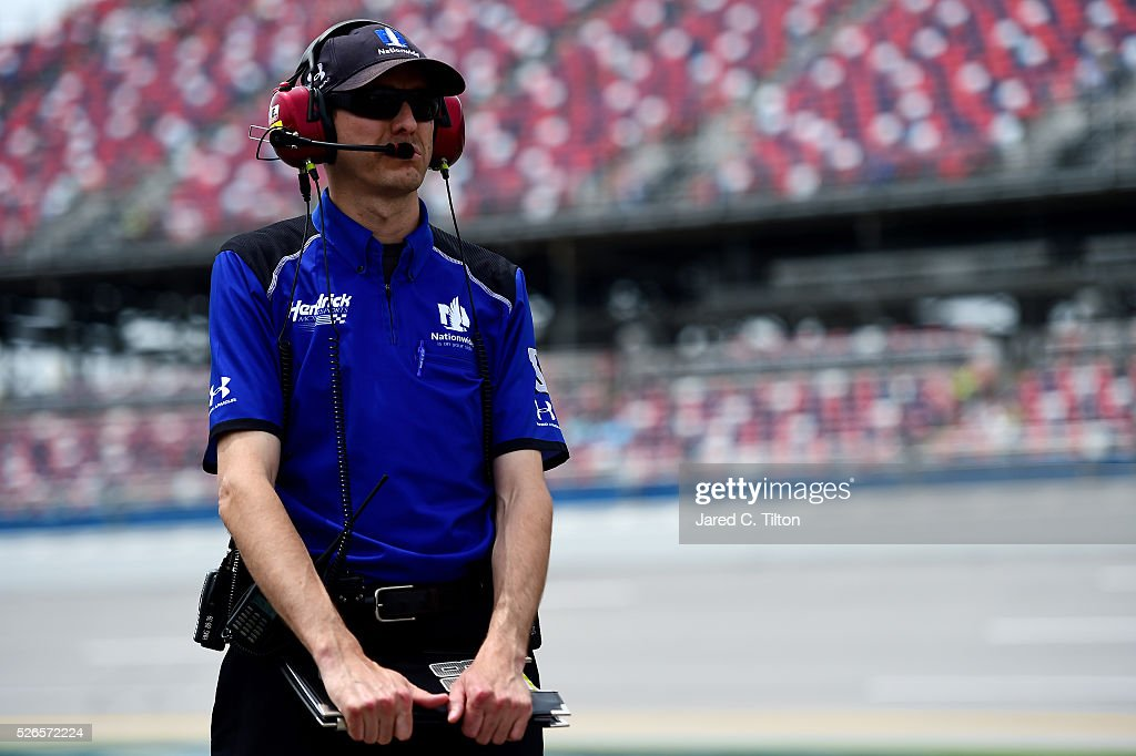 Crew chief for Dale Earnhardt Jr, driver of the #88 Nationwide Chevrolet, Greg Ives stands on the grid during qualifying for the NASCAR Sprint Cup Series GEICO 500 at Talladega Superspeedway on April 30, 2016 in Talladega, Alabama.