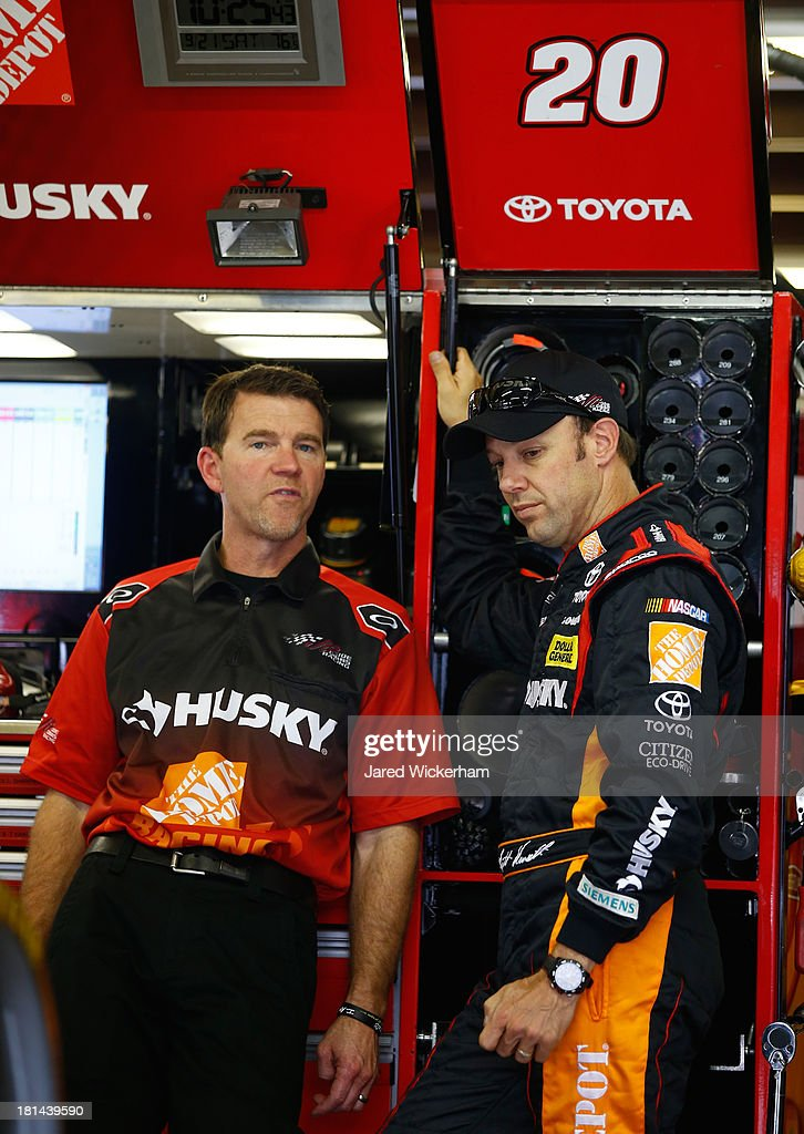 Crew chief Jason Ratcliff talks with <a gi-track='captionPersonalityLinkClicked' href=/galleries/search?phrase=Matt+Kenseth&family=editorial&specificpeople=204192 ng-click='$event.stopPropagation()'>Matt Kenseth</a>, driver of the #20 Home Depot / Husky Toyota, in the garage during practice for the NASCAR Sprint Cup Series Sylvania 300 at New Hampshire Motor Speedway on September 21, 2013 in Loudon, New Hampshire.