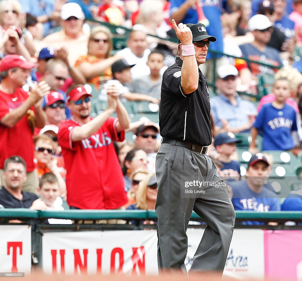 Crew chief Jeff Kellogg signals home run for Adrian Beltre #29 of the Texas Rangers on his ball hit in the fifth inning after reviewed against the Houston Astros at Minute Maid Park on May 12, 2013 in Houston, Texas.
