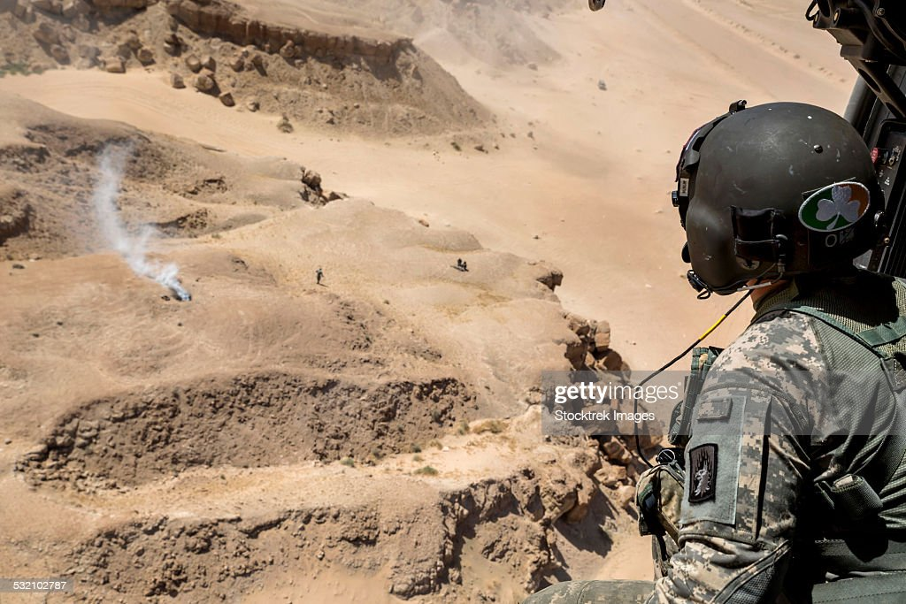 A crew chief monitors the surroundings from a SA 330 Puma helicopter.
