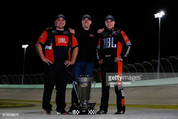 Crew chief Ryan Fugle team owner Kyle Busch and Christopher Bell driver of the JBL Toyota poses with the trophy after winning the Camping World Truck...