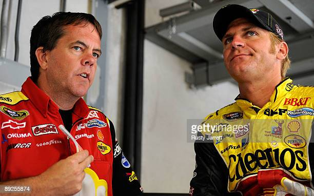Crew chief Shane Wilson speaks with Clint Bowyer driver of the Cheerios/Hamburger Helper Chevrolet during practice for the NASCAR Sprint Cup Series...