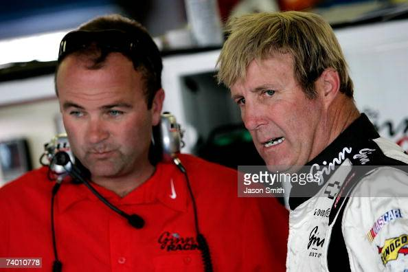 Crew chief Slugger Labbe talks with Sterling Marlin driver of the Waste Management Chevrolet in the garage during practice for the NASCAR Nextel Cup...