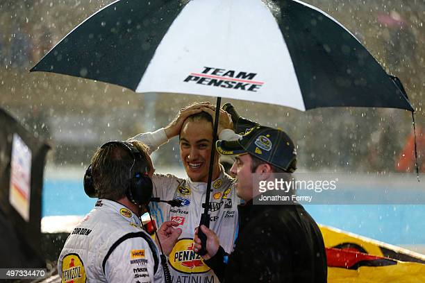Crew chief Todd Gordon talks to Joey Logano driver of the Pennzoil Ford on pit road after the rainshortened NASCAR Sprint Cup Series Quicken Loans...