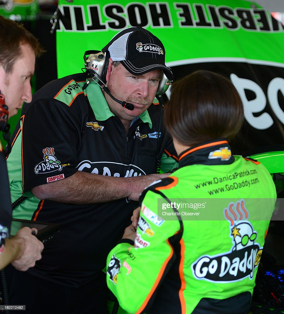 NASCAR crew chief Tony Gibson listens to driver Danica Patrick following practice laps on Wednesday, Febraury 20, 2013, at Daytona International Speedway in Daytona Beach, Florida.