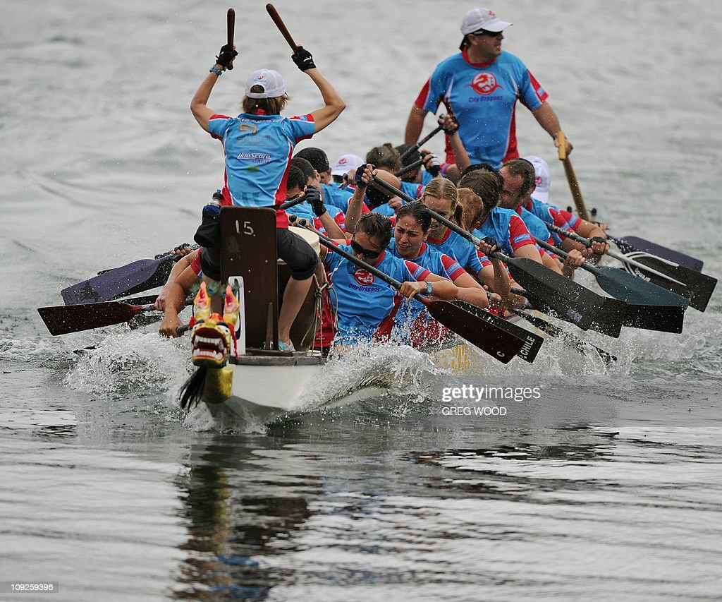 A crew competes in a Lunar New Year festival dragon boat race on Darling Harbour in Sydney on February 12, 2011. The event, held over two days and billed as the biggest meet in the southern hemisphere, sees more than 3,000 paddlers racing in brilliantly coloured dragon boats. AFP PHOTO / Greg WOOD