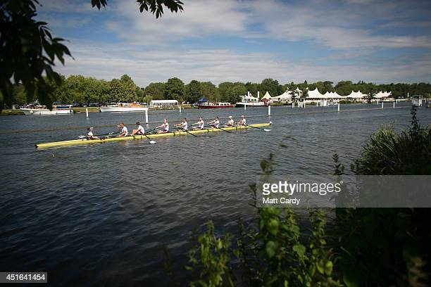 A crew competes in a race at the Henley Royal Regatta on July 3 2014 in HenleyonThames England Opening yesterday and celebrating its 175th year the...