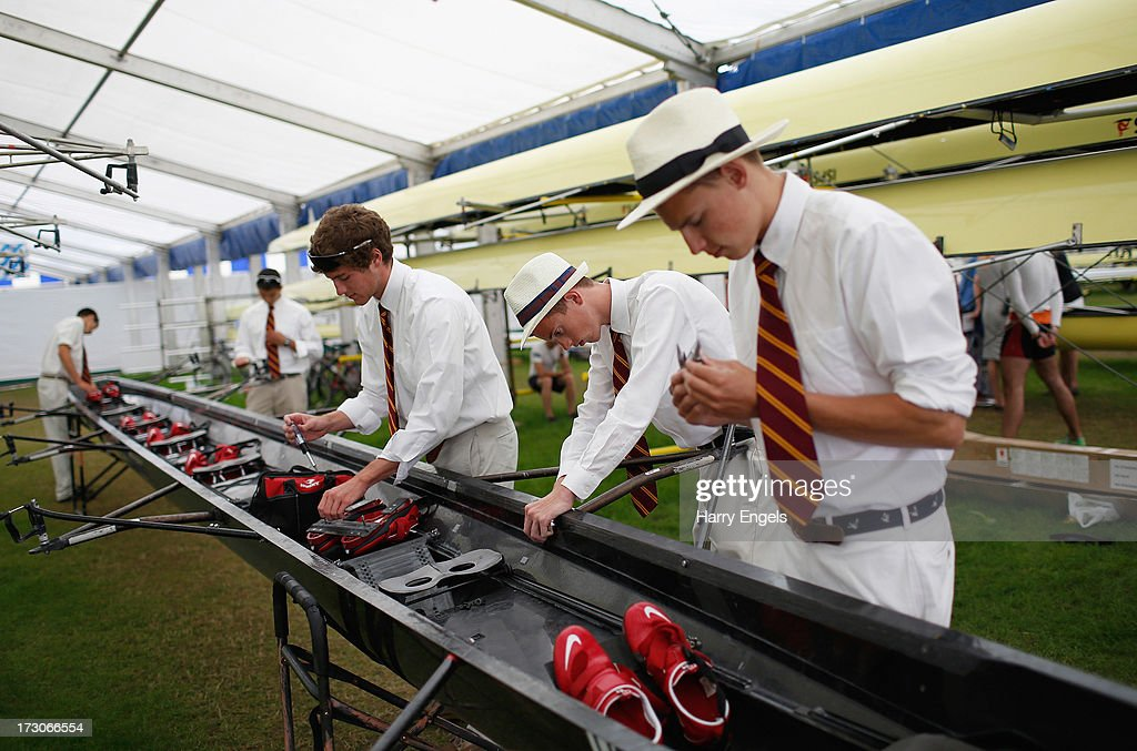 A crew dismantle their boat after losing their race the previous day on day four of the Henley Royal Regatta on July 6, 2013 in Henley-on-Thames, England.