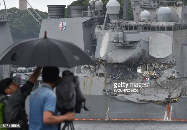 TV crew films the damages on the guided missile destroyer USS Fitzgerald at its mother port in Yokosuka southwest of Tokyo on June 18 2017 A number...