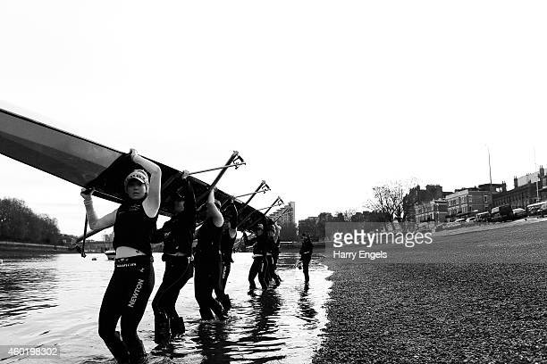 A crew from the Oxford University Women's Boat Club lift their boat out of the water after a training session ahead of the Oxford University Women's...