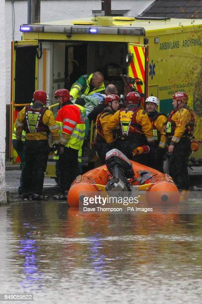 A crew from the RNLI and paramedics move a stretcher from a lifeboat into the back of an ambulance in St Asaph Denbighshire North Wales after the...