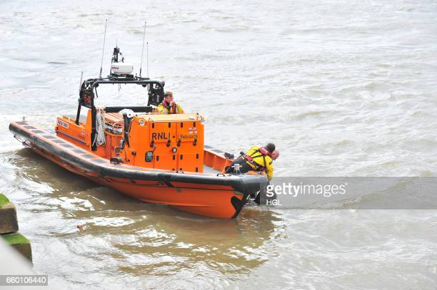 Crew from the Tower Lifeboat station pull a person from the River Thames beneath Westminster Bridge on March 29 2017 in London England