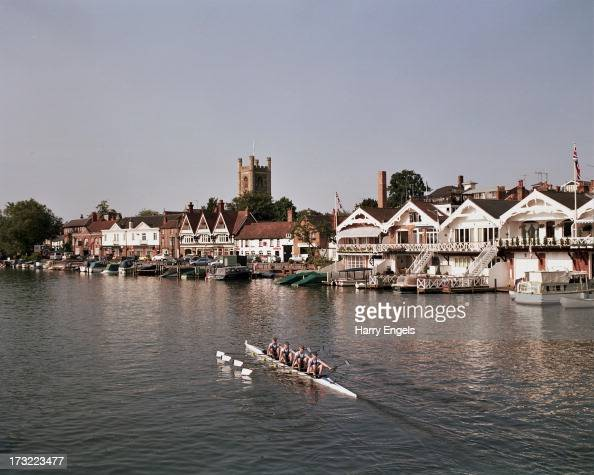 A crew heads back to the jetty after completing a warm up row during the Henley Royal Regatta on July 7 2013 in HenleyonThames England