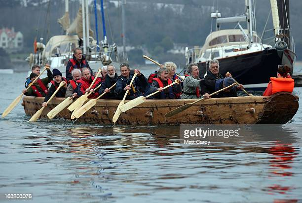Crew in Britain's first ever fullsize reconstructed seagoing Bronze Age boat paddle out to sea near to the National Maritime Museum as it makes its...