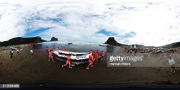 Crew launch their boats for the Piha Big Wave Classic at Piha Beach on February 27 2016 in Auckland New Zealand