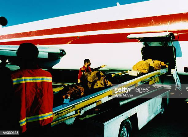 Crew Loading Cargo Onto Airplane