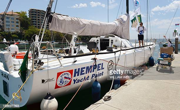 Crew look at the rigging on the Volvo 70 yacht Ichiban as teams prepare for the gruelling Sydney to Hobart yacht race which sets sail on Boxing Day...