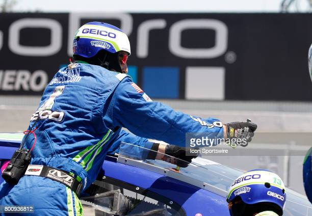 A crew man makes a track bar adjustment on Ty Dillon's car during the NASCAR Monster Energy Cup Series Toyota/Save Mart 350 on June 25 2017 at Sonoma...