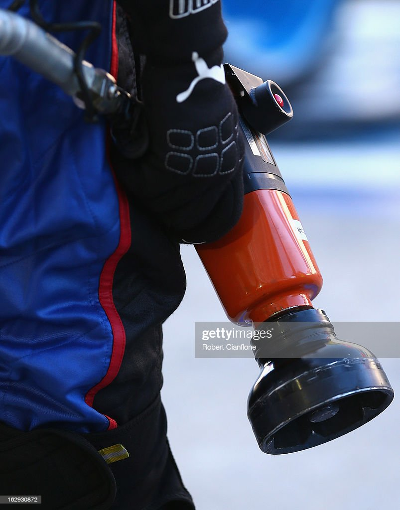 A crew member from the Pepsi Max Crew FPR team holds a rattle gun during the warm up session prior to race one of the Clipsal 500, which is round one of the V8 Supercar Championship Series, at the Adelaide Street Circuit on March 2, 2013 in Adelaide, Australia.