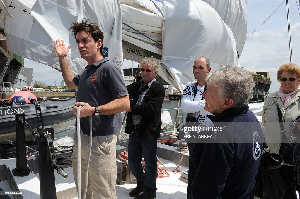 A crew member (L) gives explanations during a public visit on the French Tara Oceans boat on May 18, 2013, in Lorient, western France, on the eve of its departure for a 25.000km tour of the Arctic ocean that will last seven months. French Tara Oceans boat navigates across all the world's major oceans to sample and investigate microorganisms in the largest ecosystem on the planet.