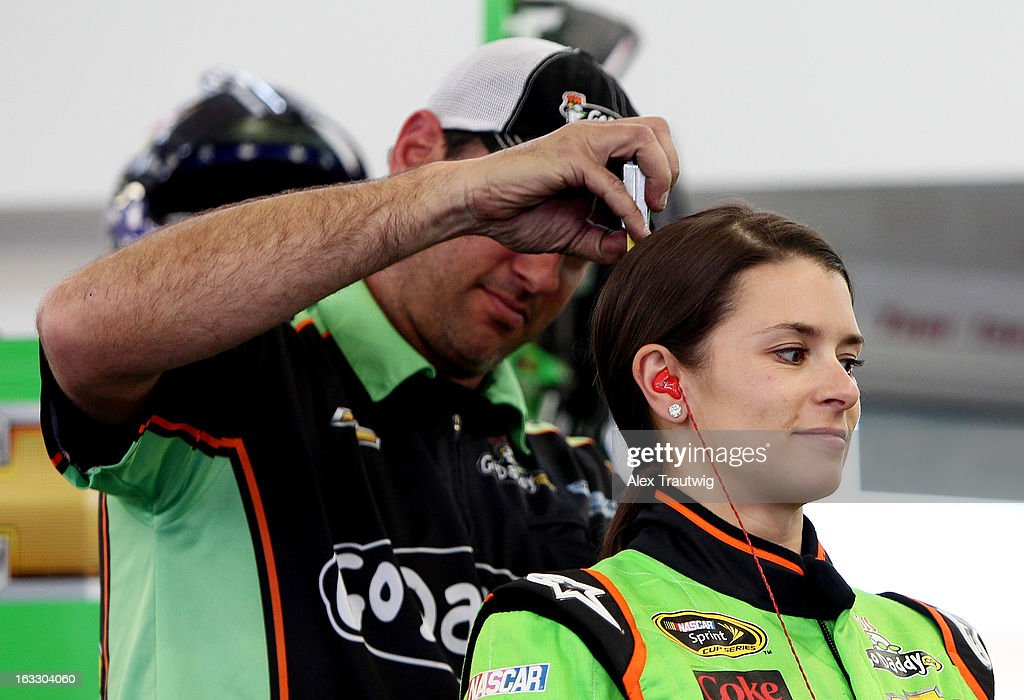 A crew member holds a tape measure to <a gi-track='captionPersonalityLinkClicked' href=/galleries/search?phrase=Danica+Patrick&family=editorial&specificpeople=183352 ng-click='$event.stopPropagation()'>Danica Patrick</a>, driver of the #10 GoDaddy Racing Chevrolet, in the garage area during NASCAR Sprint Cup Series testing at Las Vegas Motor Speedway on March 7, 2013 in Las Vegas, Nevada.