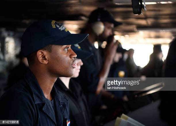 A crew member looks on from the bridge of the USS Ronald Reagan on July 14 2017 in Townsville Australia USS Ronald Reagan is a 1092 foot aircraft...