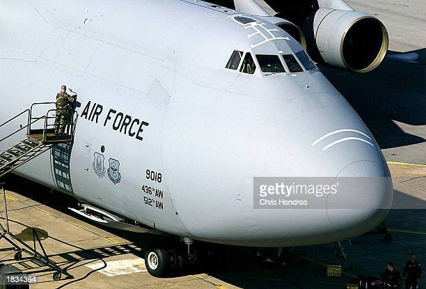 A crew member makes adjustments to the hull of a C5 cargo plane the largest in the US military March 7 2003 at Incirlik Air Force Base in Turkey...