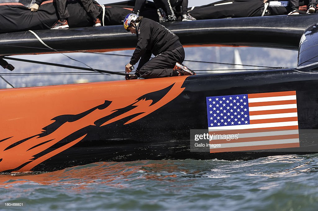 USA crew member makes some minor adjustments to the boat with a power tool during day 4 of the America's Cup on September 12th, 2013 in San Francisco.