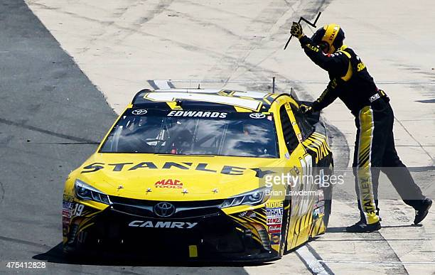 Crew member Matt Ver Meer pulls a wedge wrench from the Stanley Toyota of Carl Edwards on pit road during the NASCAR Sprint Cup Series FedEx 400...