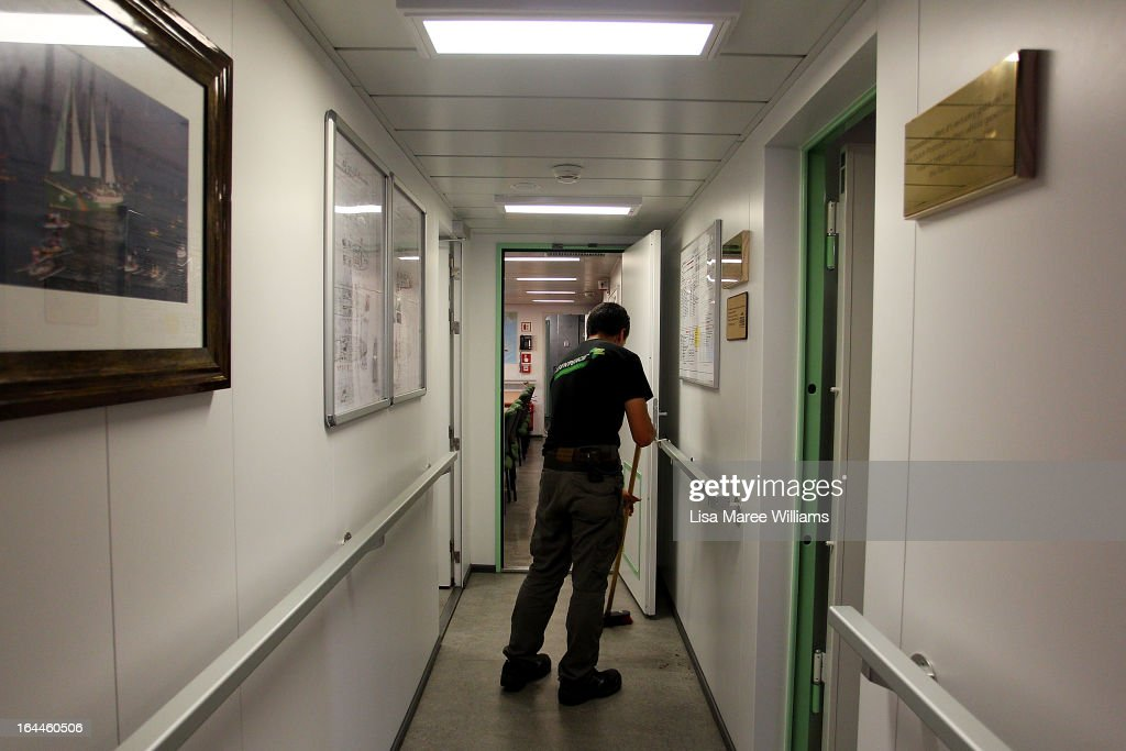 Crew member Nazareth Sanzini cleans a hallway on the Greenpeace Rainbow Warrior whilst docked at the Overseas Passenger Terminal in Circular Quay on March 24, 2013 in Sydney, Australia. The vessel is in Australia to protest new coal mines set to open near the Great Barrier Reef, and is opening for public viewing at ports across the country. The original Rainbow Warrior was bombed and sunk in Auckland Harbour in 1985 by two French intelligent agents, killing a Dutch photographer on board.