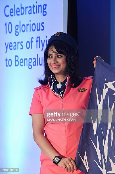 A crew member of British Airways showcases one of the cabin crew uniforms from the airline's 76year history during a fashion show held in Bangalore...