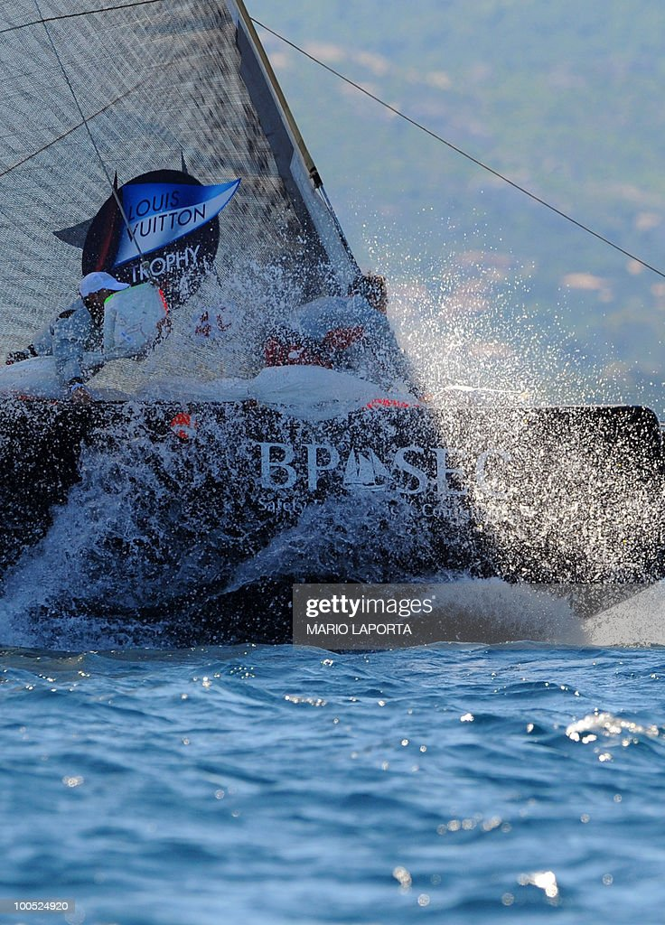 A crew member of Italian Team Luna Rossa prepares the spinnaker during a match race regatta against Russian Sinergy Sailing Team at the Louis Vuitton Trophy on May 24, 2010 at La Maddalena island in Sardinia. Ten teams battle it out over a two-week regatta begun on May 22 until June 6, 2010.