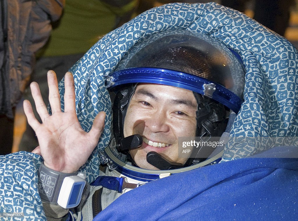 A crew member of the International Space Station (ISS), Akihiko Hoshide of Japan, waves shortly after his landing in Soyuz capsule near the town of Arkalyk in northern Kazakhstan, early on November 19, 2012. Russian cosmonaut Yury Malenchenko and two astronauts, Sunita Williams of the US and Akihiko Hoshide of Japan, touched down early today on the steppes of Kazakhstan in a Russian Soyuz capsule after spending over four months aboard the International Space Station (ISS). AFP PHOTO / POOL / SERGEI REMEZOV
