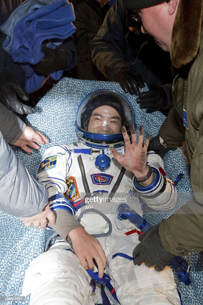 A crew member of the International Space Station (ISS), Akihiko Hoshide of Japan, waves shortly after his landing in Soyuz capsule near the town of Arkalyk in northern Kazakhstan, early on November 19, 2012. Russian cosmonaut Yury Malenchenko and two astronauts, Sunita Williams of the US and Akihiko Hoshide of Japan, touched down early today on the steppes of Kazakhstan in a Russian Soyuz capsule after spending over four months aboard the International Space Station (ISS).