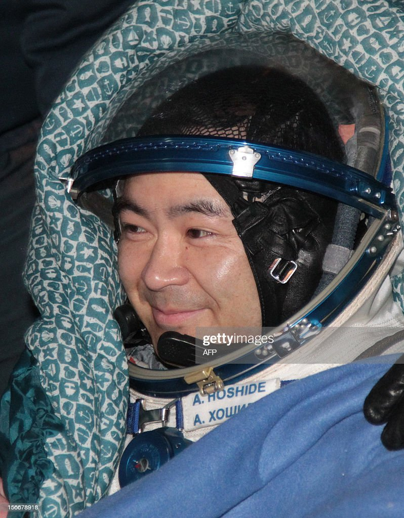 A crew member of the International Space Station (ISS), Japanese astronaut <a gi-track='captionPersonalityLinkClicked' href=/galleries/search?phrase=Akihiko+Hoshide&family=editorial&specificpeople=5329772 ng-click='$event.stopPropagation()'>Akihiko Hoshide</a>, smiles shortly after his landing in Soyuz capsule near the town of Arkalyk in northern Kazakhstan, early on November 19, 2012. Russian cosmonaut Yury Malenchenko and two astronauts, Sunita Williams of the US and <a gi-track='captionPersonalityLinkClicked' href=/galleries/search?phrase=Akihiko+Hoshide&family=editorial&specificpeople=5329772 ng-click='$event.stopPropagation()'>Akihiko Hoshide</a> of Japan, touched down early today on the steppes of Kazakhstan in a Russian Soyuz capsule after spending over four months aboard the International Space Station (ISS).