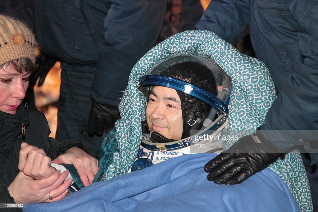 A crew member of the International Space Station (ISS), Japanese astronaut <a gi-track='captionPersonalityLinkClicked' href=/galleries/search?phrase=Akihiko+Hoshide&family=editorial&specificpeople=5329772 ng-click='$event.stopPropagation()'>Akihiko Hoshide</a>, smiles shortly after his landing in Soyuz capsule near the town of Arkalyk in northern Kazakhstan, early on November 19, 2012. Russian cosmonaut Yury Malenchenko and two astronauts, Sunita Williams of the US and <a gi-track='captionPersonalityLinkClicked' href=/galleries/search?phrase=Akihiko+Hoshide&family=editorial&specificpeople=5329772 ng-click='$event.stopPropagation()'>Akihiko Hoshide</a> of Japan, touched down early today on the steppes of Kazakhstan in a Russian Soyuz capsule after spending over four months aboard the International Space Station (ISS). AFP PHOTO / POOL /MAXIM SHIPENKOV